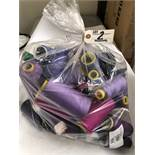 Bag of assorted purple colored thread rolls