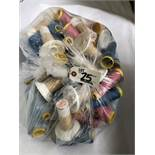 Bag of assorted colored thread rolls