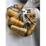 Bag of assorted golden colored thread rolls