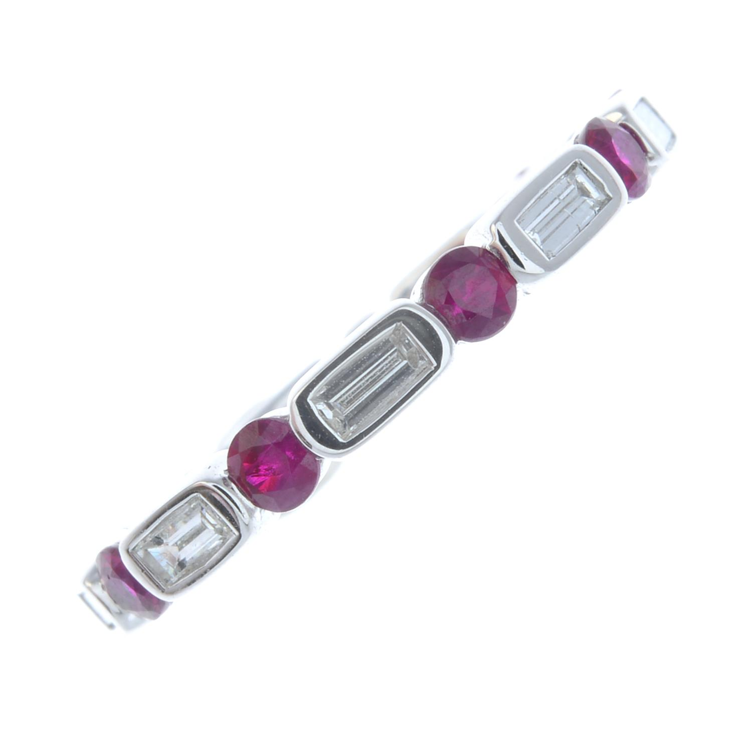 Lot 45 - A ruby and diamond full eternity ring.