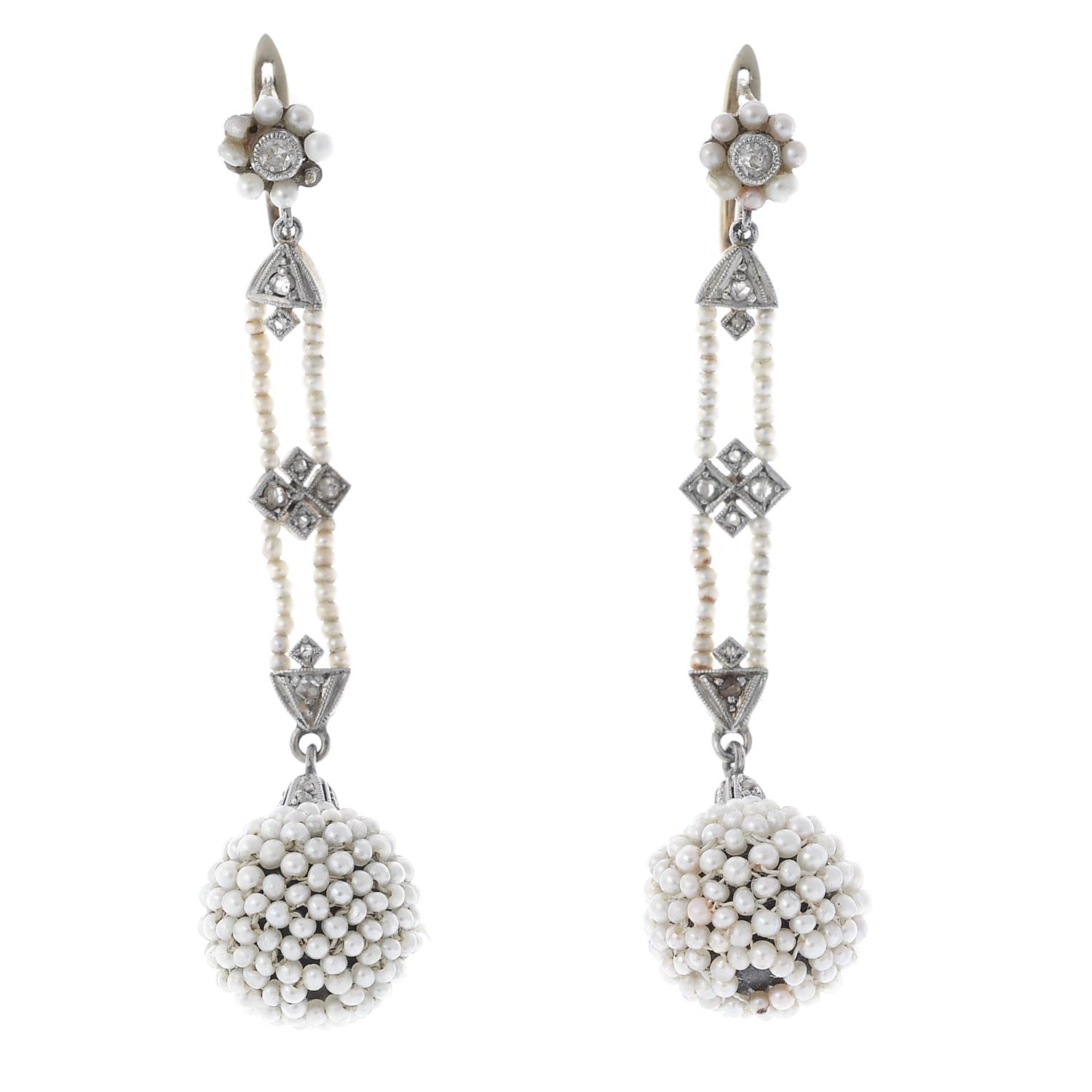 Lot 17 - A pair of early 20th century seed pearl and diamond earrings.