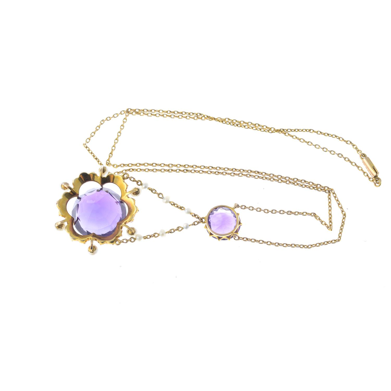 Lot 28 - An early 20th century 15ct gold amethyst and seed pearl necklace.