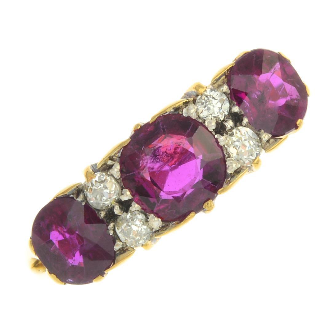 Lot 44 - An early 20th century 18ct gold Thai ruby three-stone and diamond ring.
