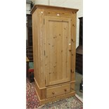A modern pine single-door wardrobe on drawer base, 95cm wide.