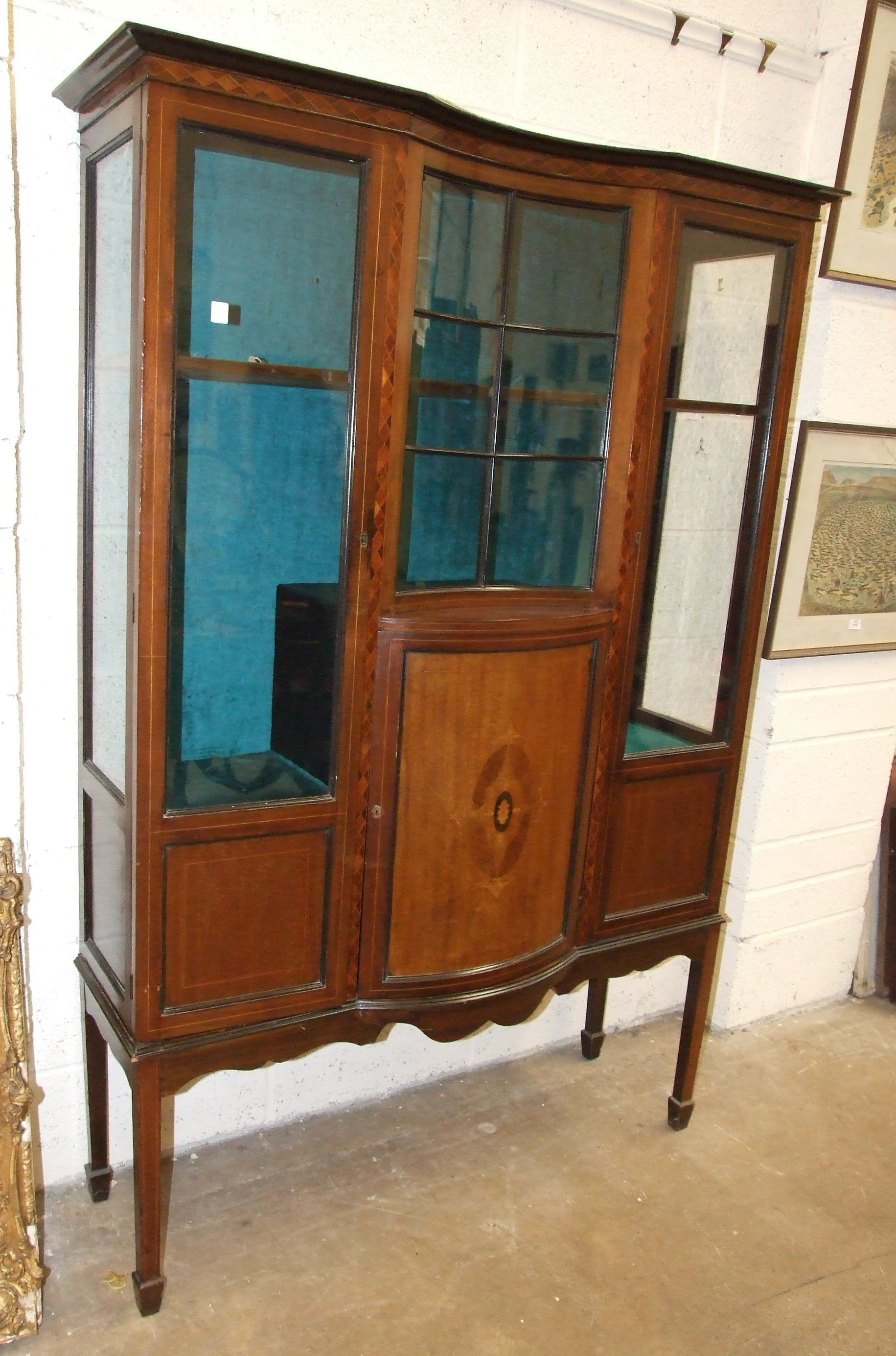 Lot 11 - An Edwardian inlaid mahogany glazed display cabinet on square legs and spade feet, 118cm wide, 173cm