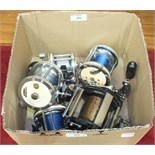 A collection of five multiplier fishing reels, including Garcia Mitchell 624 x2, 622, 602A and a G &