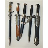 Five replica WWII German daggers, (5).