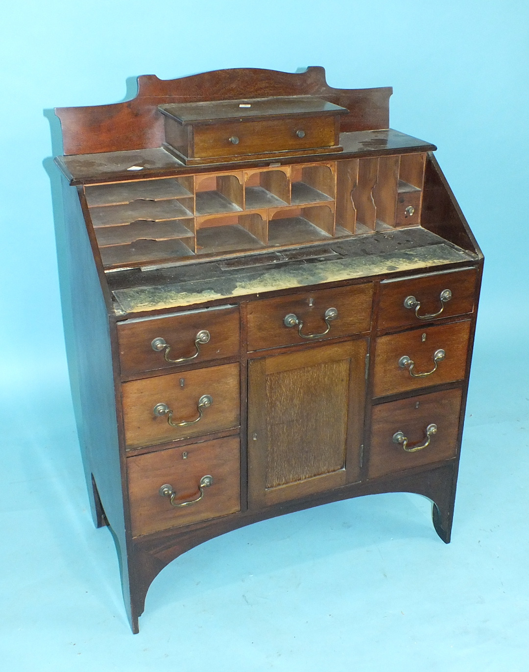 A late-19th/early-20th century mahogany lady's bureau, the fall front and fitted interior above an