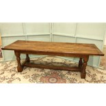 A reproduction oak refectory dining table on turned legs and H-stretcher, 259 x 84cm.