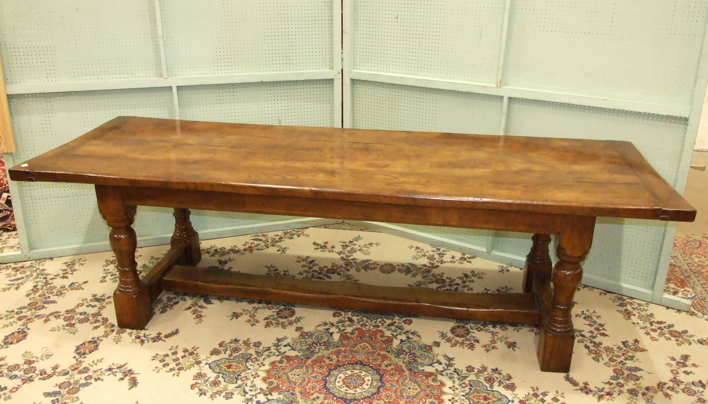 Lot 12 - A reproduction oak refectory dining table on turned legs and H-stretcher, 259 x 84cm.