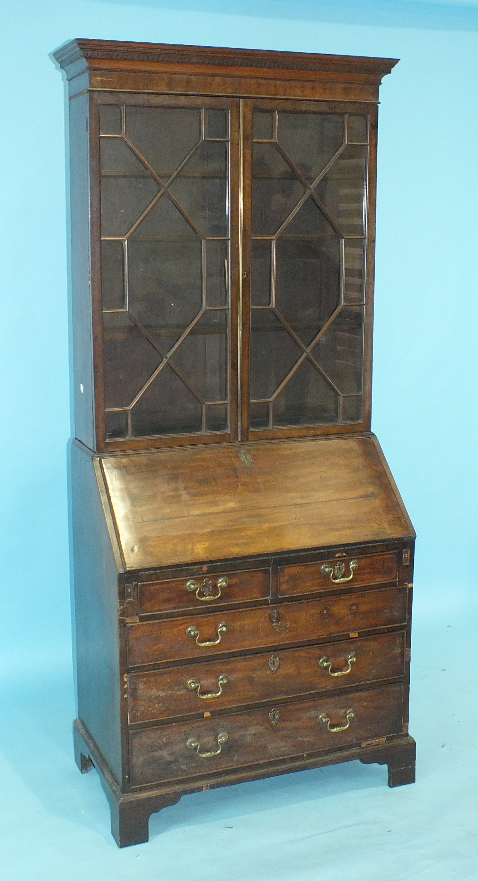 A Georgian bureau/bookcase, the dentil cornice above a pair of astragal-glazed doors, the fall front - Image 2 of 3