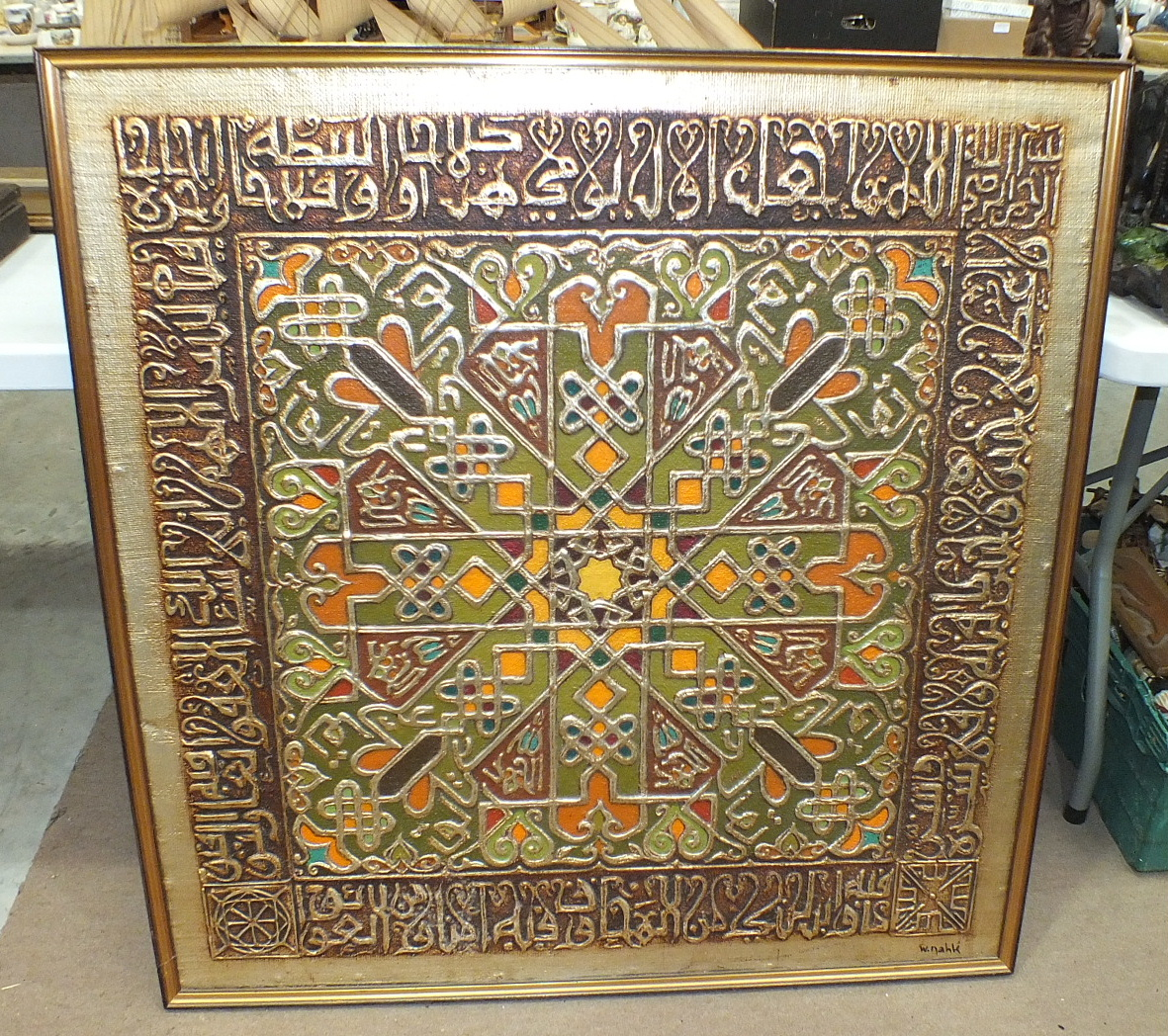 W. Nahk, a painted embossed hessian wood plaque of geometric design brightly-painted with orange,