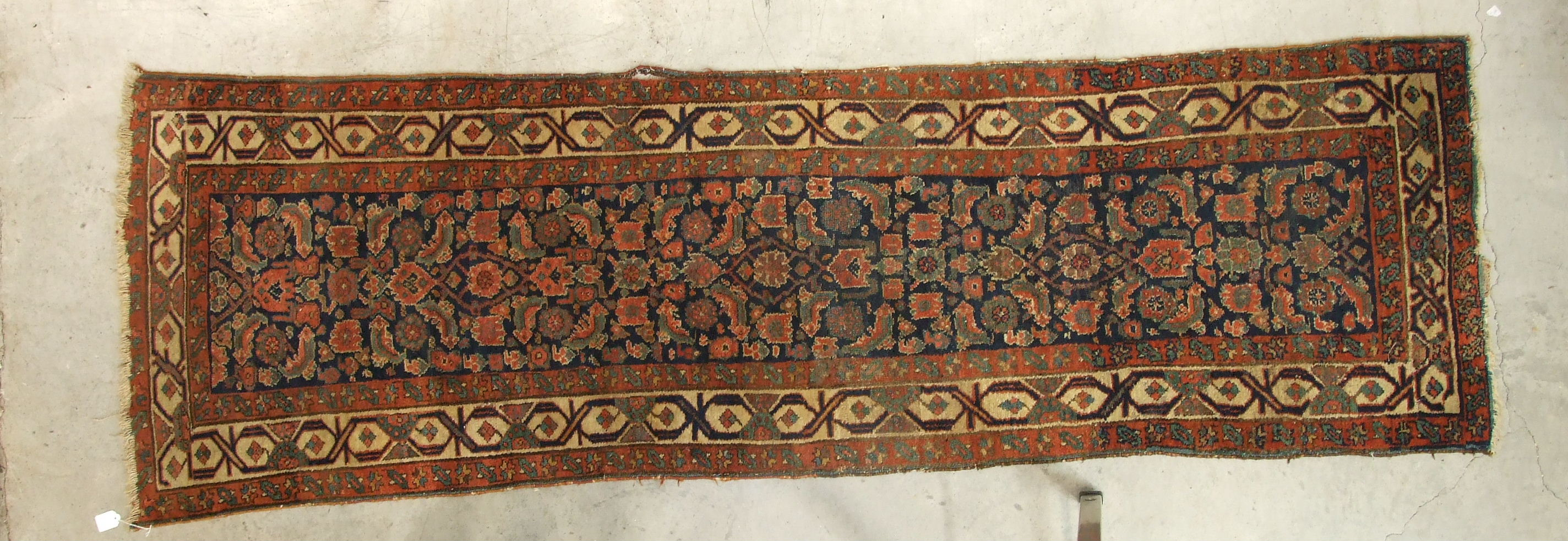 Lot 34 - A mid-20th century Oriental runner decorated with six central hooked lozenge medallions, with a