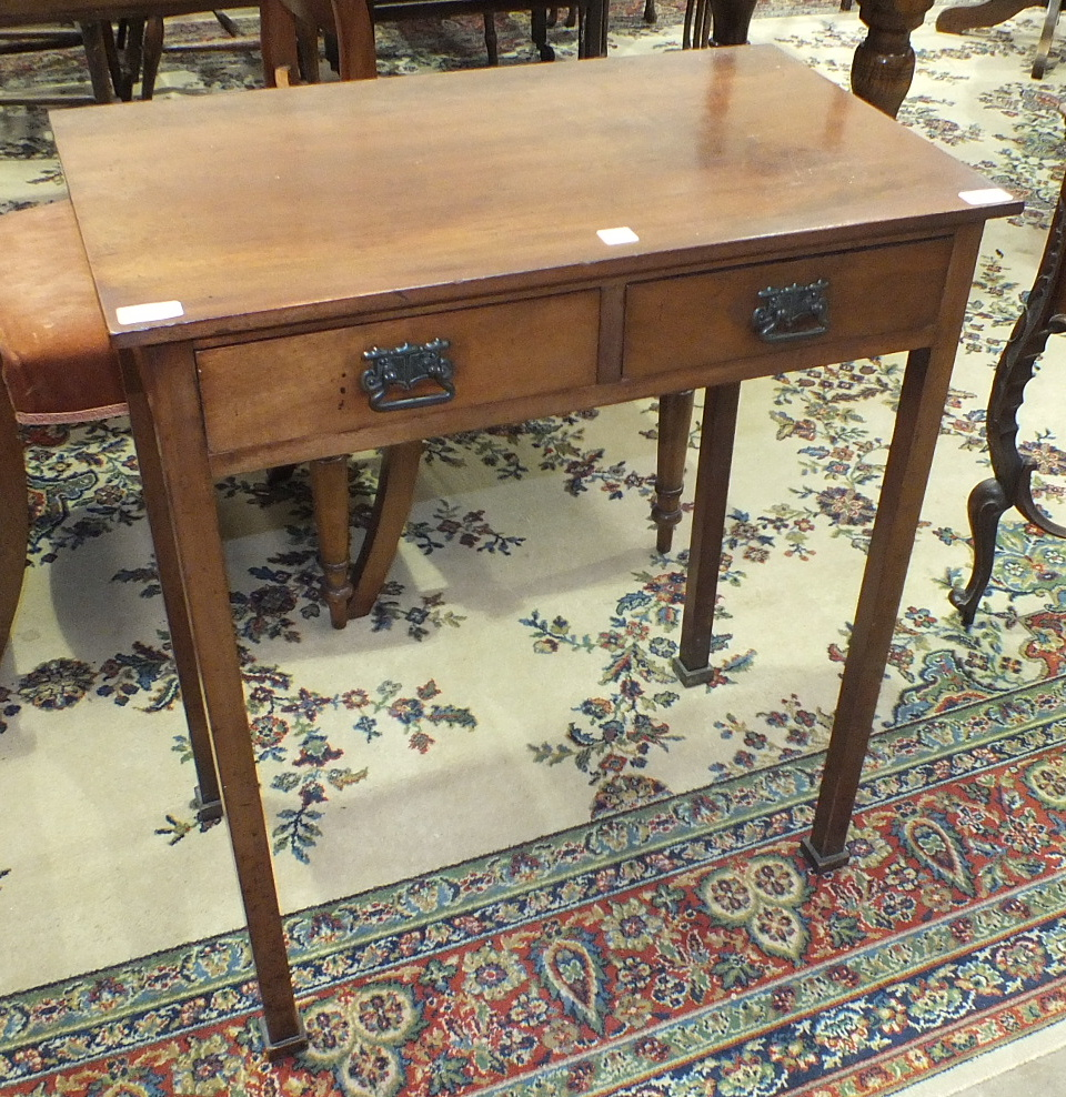 An early-20th century mahogany hall table, the rectangular top above two frieze drawers, on square