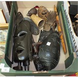 A collection of mainly 20th century African tribal artefacts, including two spears, masks, etc.