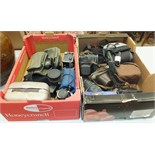 A collection of various cameras, tripods and photographic accessories.