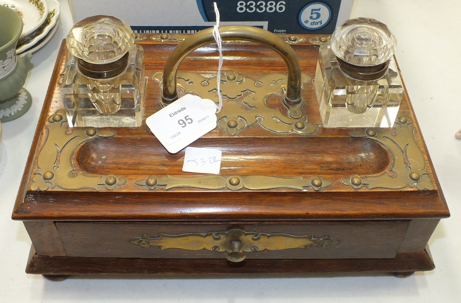Lot 95 - An oak pen and ink stand with brass mounts and handle, fitted with a single drawer, 27.5 x 18cm,