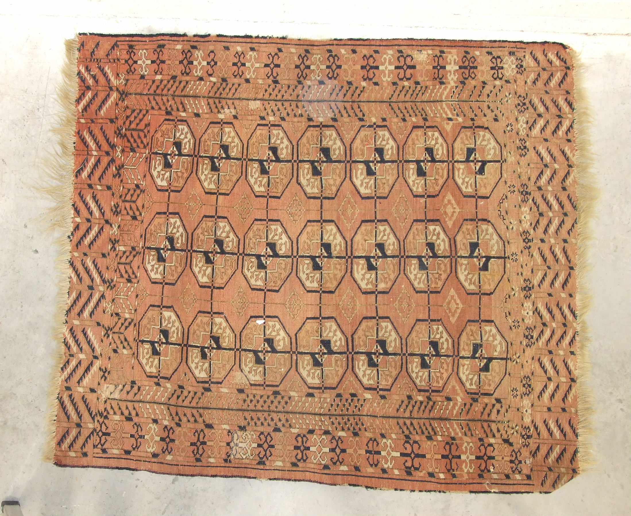 A mid-20th century wool rug, red field with central hexagonal medallions, figures leading camels and - Image 2 of 3