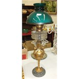 A late-19th/early-20th century oil lamp, the clear glass reservoir on gilt-painted urn-shaped column
