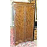 A mid-20th century walnut two-door wardrobe, 95.5cm wide.