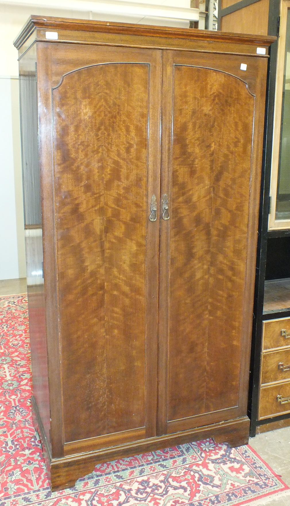 Lot 18 - A mid-20th century walnut two-door wardrobe, 95.5cm wide.