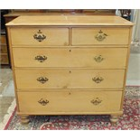 A late-19th/early-20th century stripped pine straight-front chest of two short and three long