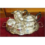 A four-piece silver plated tea service, a Selkirk Glass paperweight and two others.