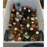 A collection of approximately sixty miniature bottles of Whisky, etc.