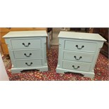 A pair of painted low three-drawer bedside chests on plinth bases, 70cm wide, 68cm high, 40.5cm