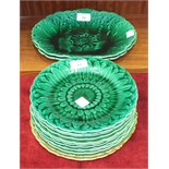 Ten Wedgwood green leaf pattern plates, 21.5cm diameter, two Wedgwood green shaped oval plates, 28 x