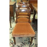 A set of six late-19th century mahogany Regency-style dining chairs on turned front legs, includes