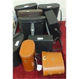 A collection of nine pairs of binoculars in cases, including 'The Plymothian' 10x40, Halina 20x50,