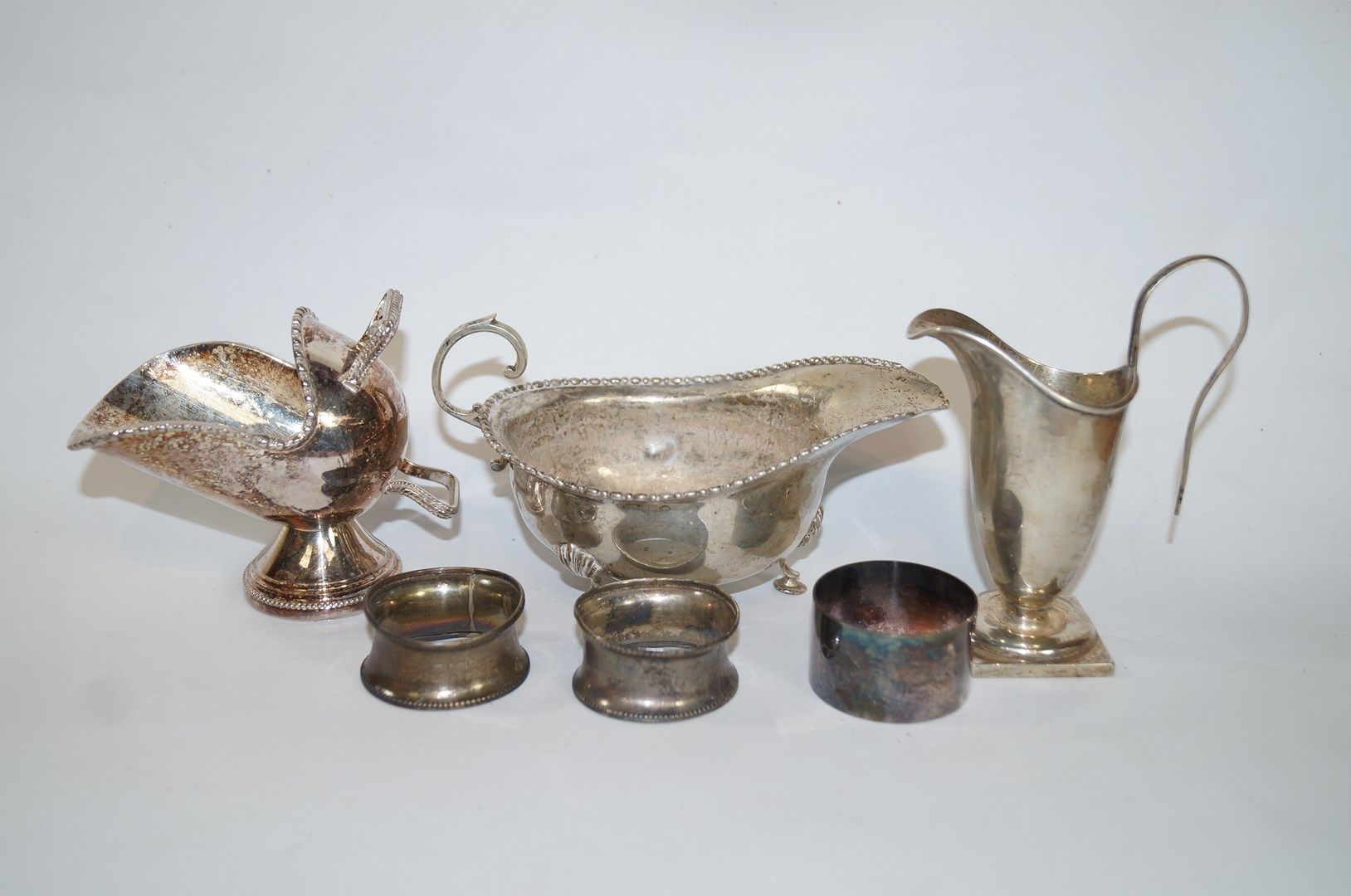 Lot 36 - A silver sauceboat, by H.