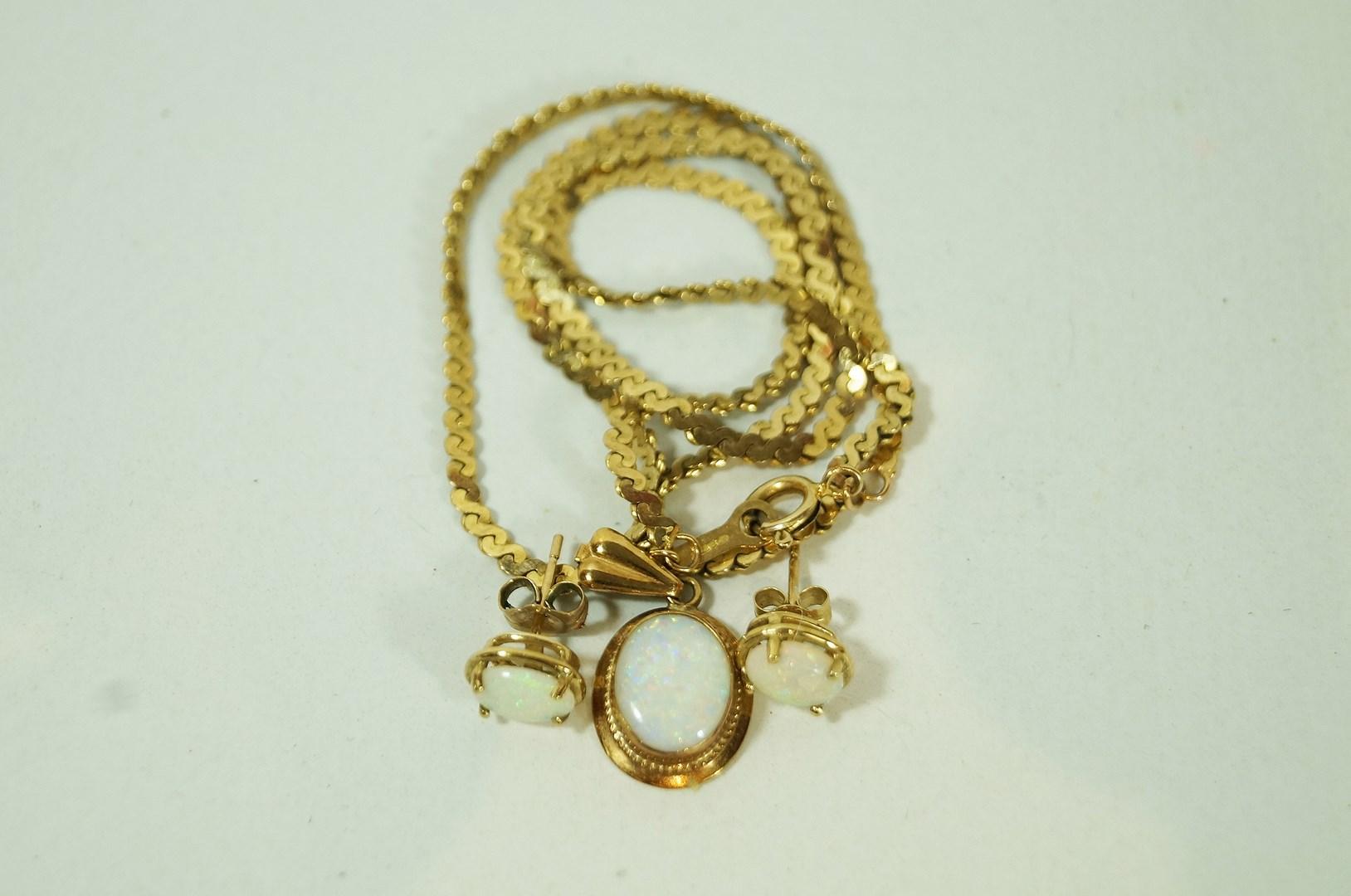 Lot 30 - An opal 9 carat gold pendant, on a 9 carat gold S link chain, pendant 2.