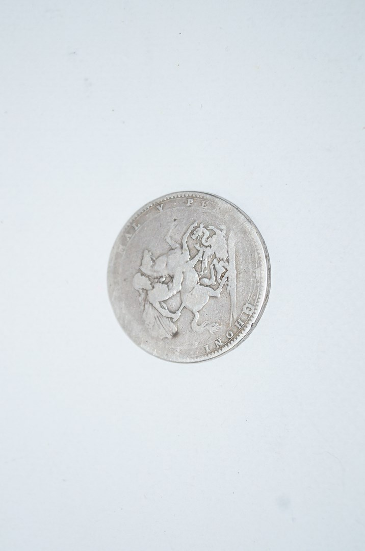 Lot 4 - An 1804 silver five shilling coin in a silver plated mount along with a George III silver half
