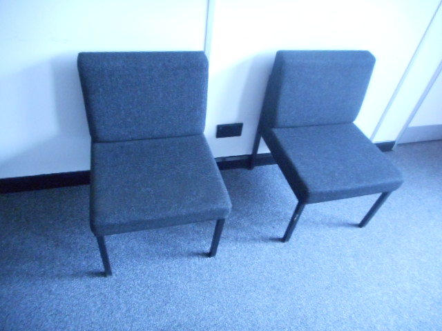 Lot 1 - 2 x RED ARMCHAIRS 2 X RED CHAIRS 1 x MATCHING RED TABLE 2 x BLACK CHAIRS and 1 x METAL COAT STAND
