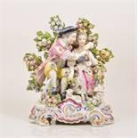 A Chelsea style porcelain bocage group, probably Samson, Paris, late 19th Century,