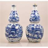 A pair of Chinese blue and white double gourd shape vases, bearing Kangxi four character mark,