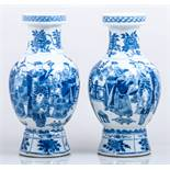 A pair of Chinese blue and white baluster shape vases, bearing Kangxi six character marks,