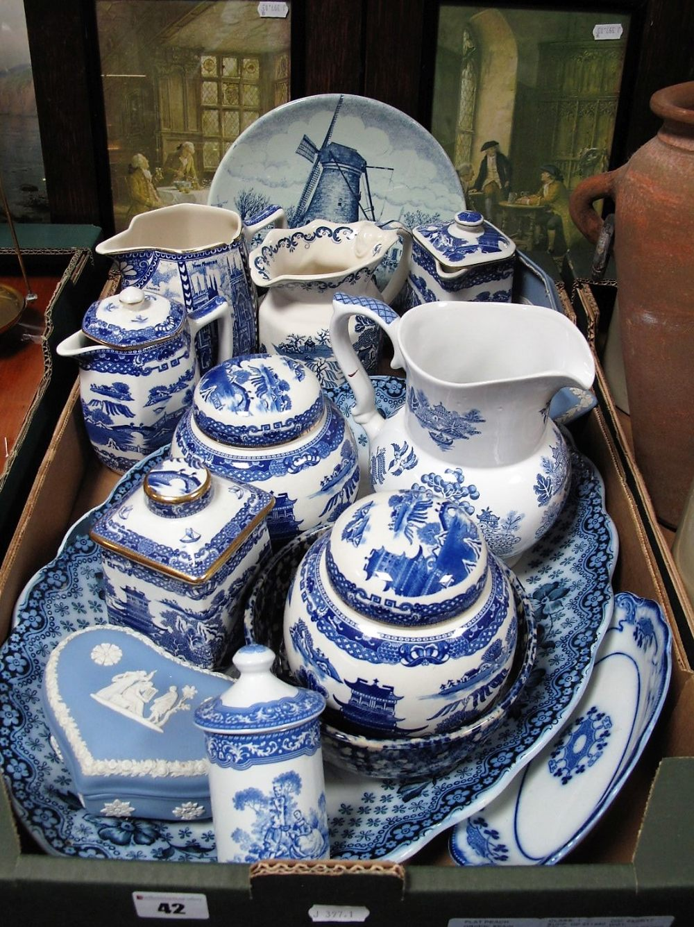 Lot 42 - Ringtons Blue and White Willow Pattern Ginger Jars, tea canister, jugs, together with Victorian oval