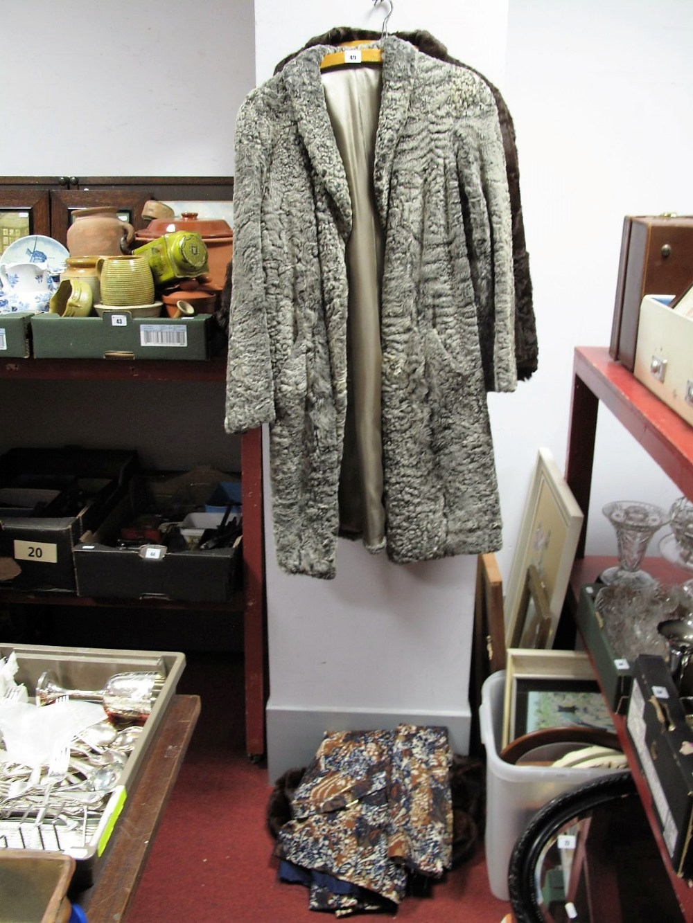 Lot 49 - An Aquascutum Coat, two fur capes and a lambs wool coat.