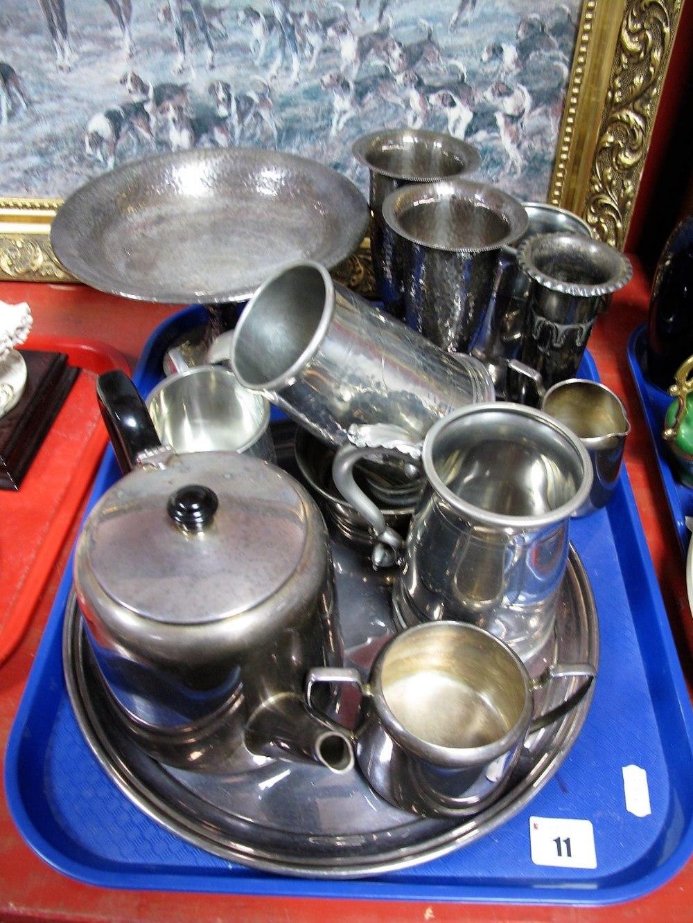 Lot 11 - An EPNS Three Piece Tea Service, EPNS hand beaten vases, pedestal bowl, tankards, etc:- One Tray