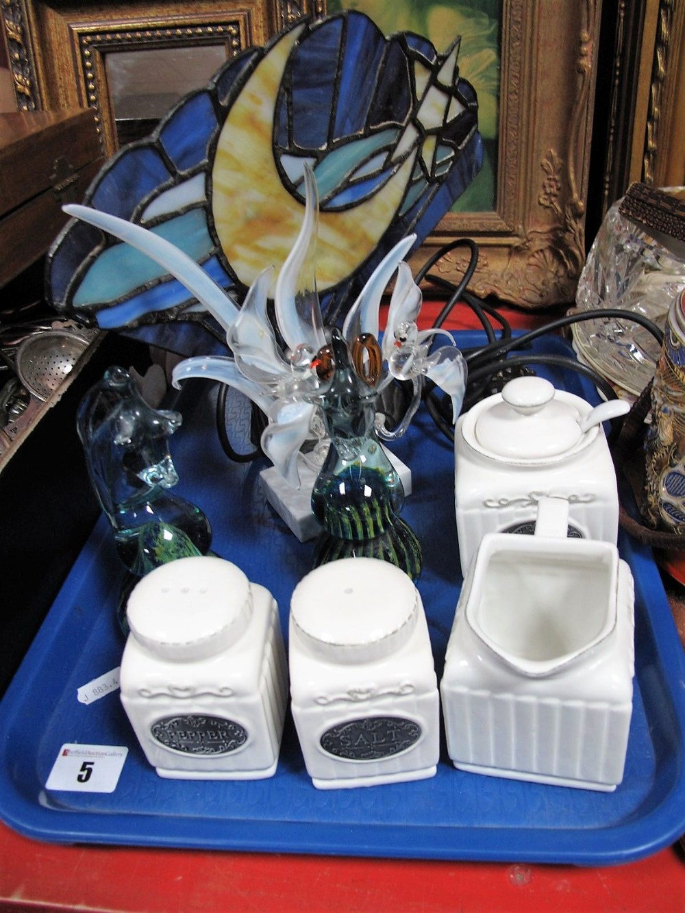 Lot 5 - A Pair of Mdina Seahorse Paperweights, a stained glass 'fan' table lamp, etc:- One Tray