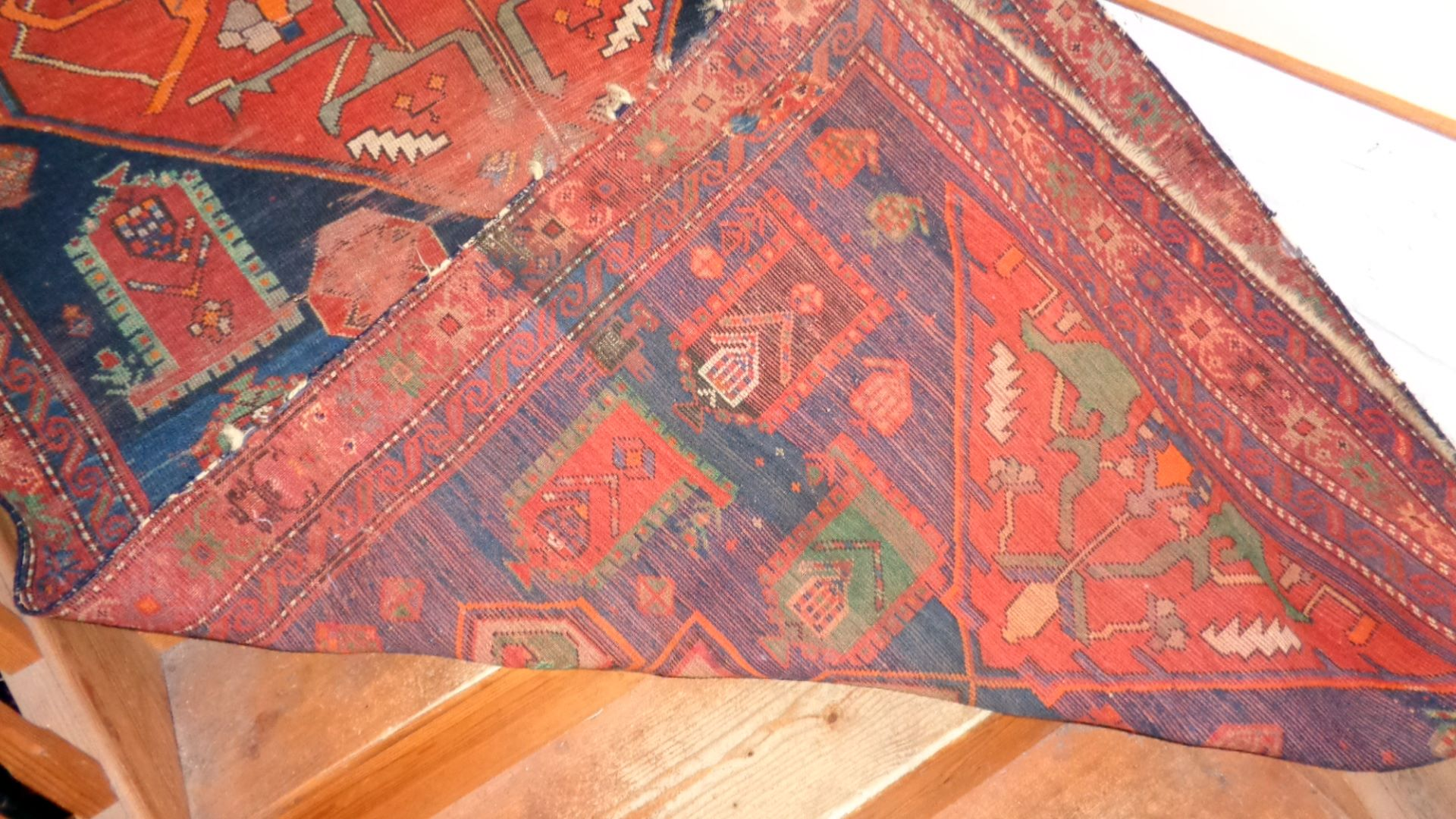 """Lot 1 - Antique Persian rug (some holes), approx 52"""" x 100"""""""