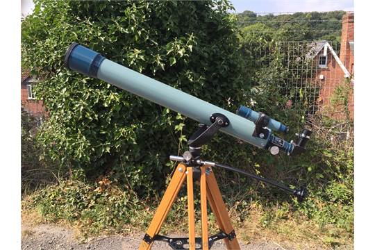 A prinz astral 400 refractor telescope with tripod eye piece