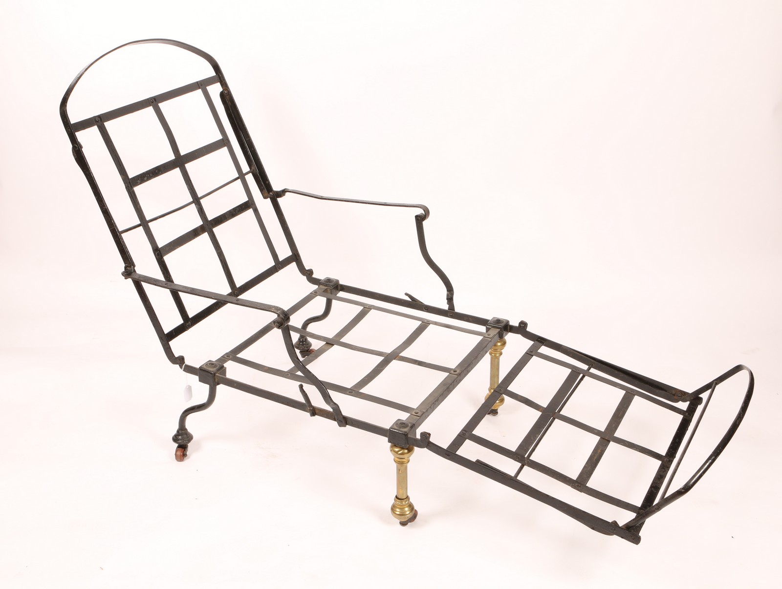 A VICTORIAN BLACK PAINTED AND BRASS FOLDING CAMPAIGN BED cum CHAIR