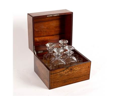 A Victorian rosewood and inlaid decanter box, the cover inlaid Liqueurs, the interior fitted four decanters and various glass