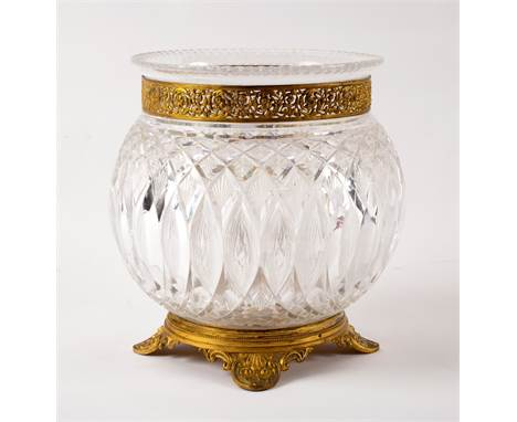 A cut glass vase with pierced gilt metal mounts on anthemion feet, 22cm high CONDITION REPORT: In good condition, no chips or