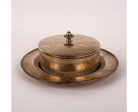 A Victorian silver butter dish, Sheffield 1884, of circular lidded form, engraved with foliate scroll work, glass liner, 17.5