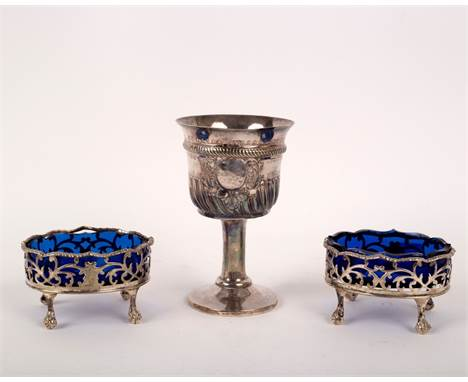 A pair of George III oval silver salts, London 1768, with blue glass liners, 8cm wide, together with a chalice, the bowl init